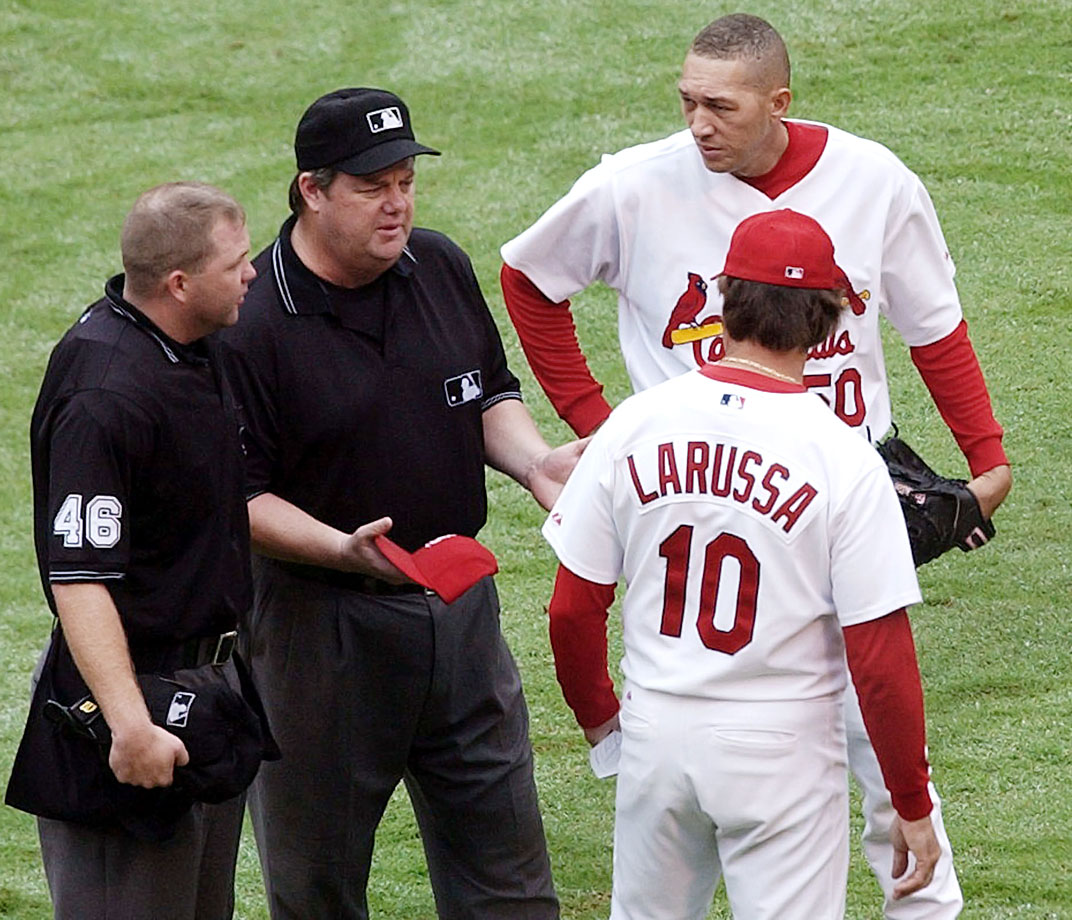 Julian Tavarez of the St. Louis Cardinals was hit with a 10-day suspension after umpires discovered pine tar on his dirty cap.
