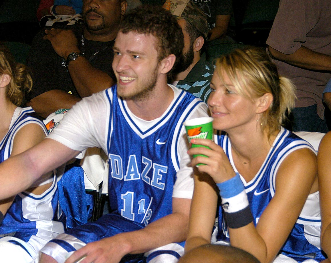 Justin Timberlake and Cameron Diaz smile from the bench during *NSYNC's Challenge for the Children VI Celebrity Basketball Game at Office Depot Center in Sunrise, Fla., on July 25, 2004.