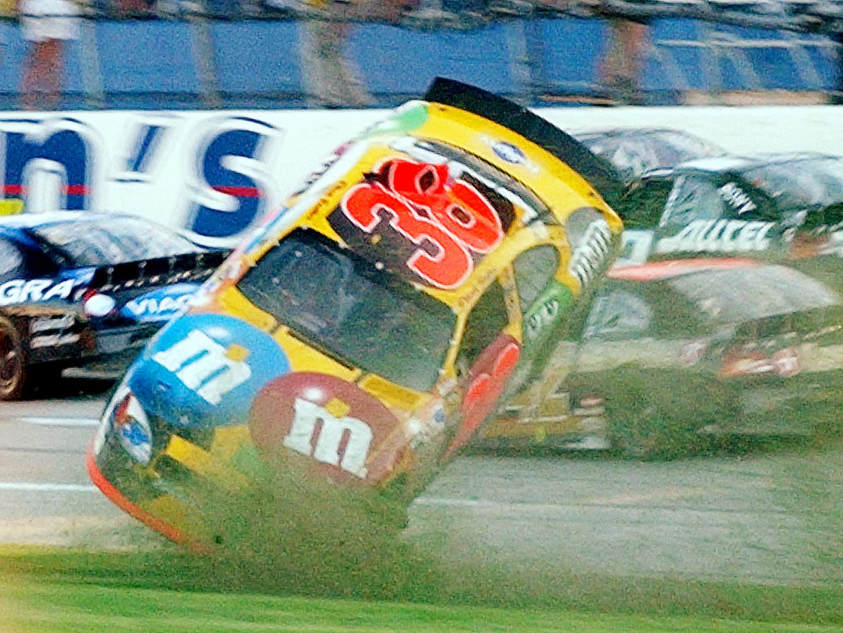 Elliott Sadler sliding backward through the grass and flipping once before sliding across the finish line on his wheels on the last lap.