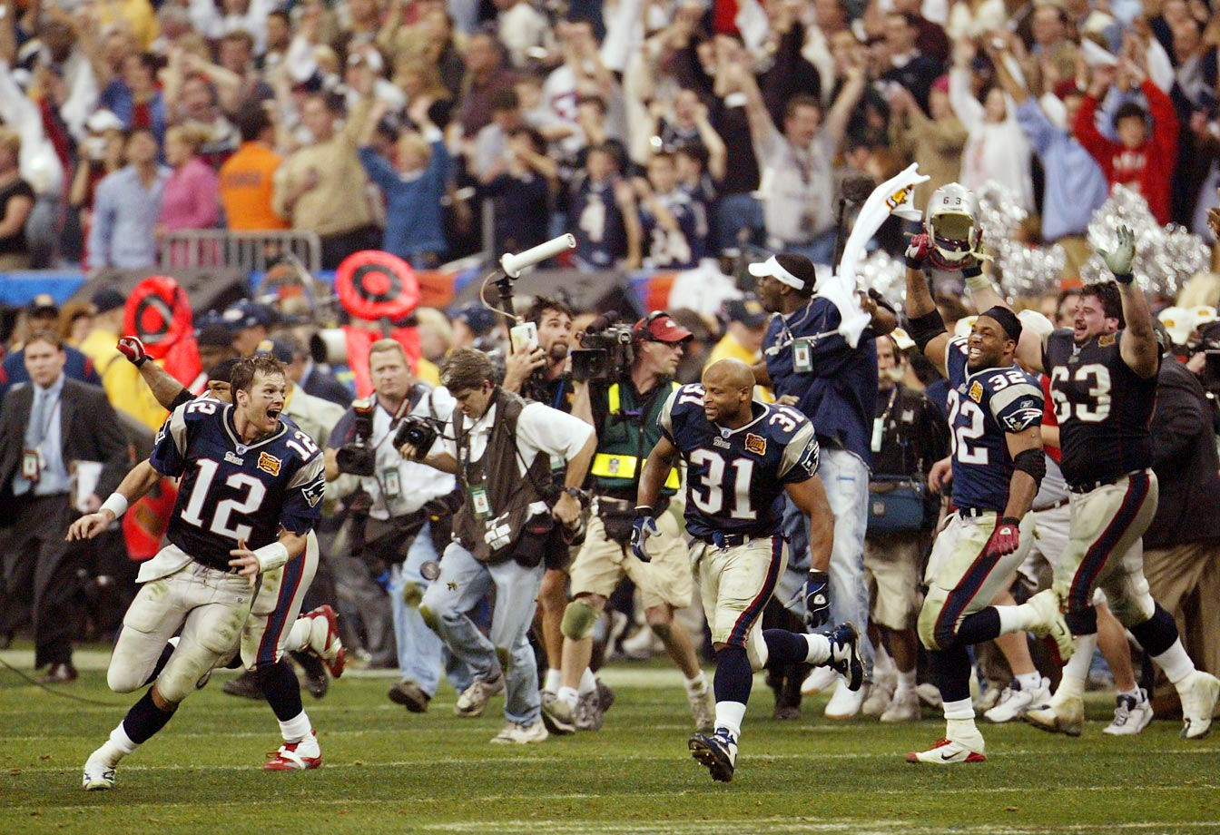Tom Brady lead the Patriots in celebration at the conclusion of their victory over Carolina. The game was decided on a 41-yard field goal by Adam Vinatieri with four seconds remaining.