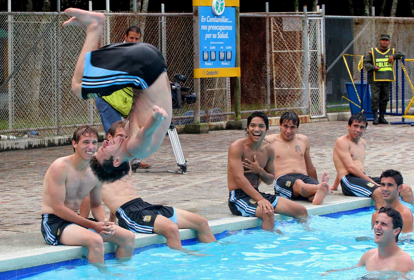Lionel Messi flips into a pool during a relaxed practice of Argentina's Under-20 soccer team on Jan. 14, 2005 in Pereira, Colombia.