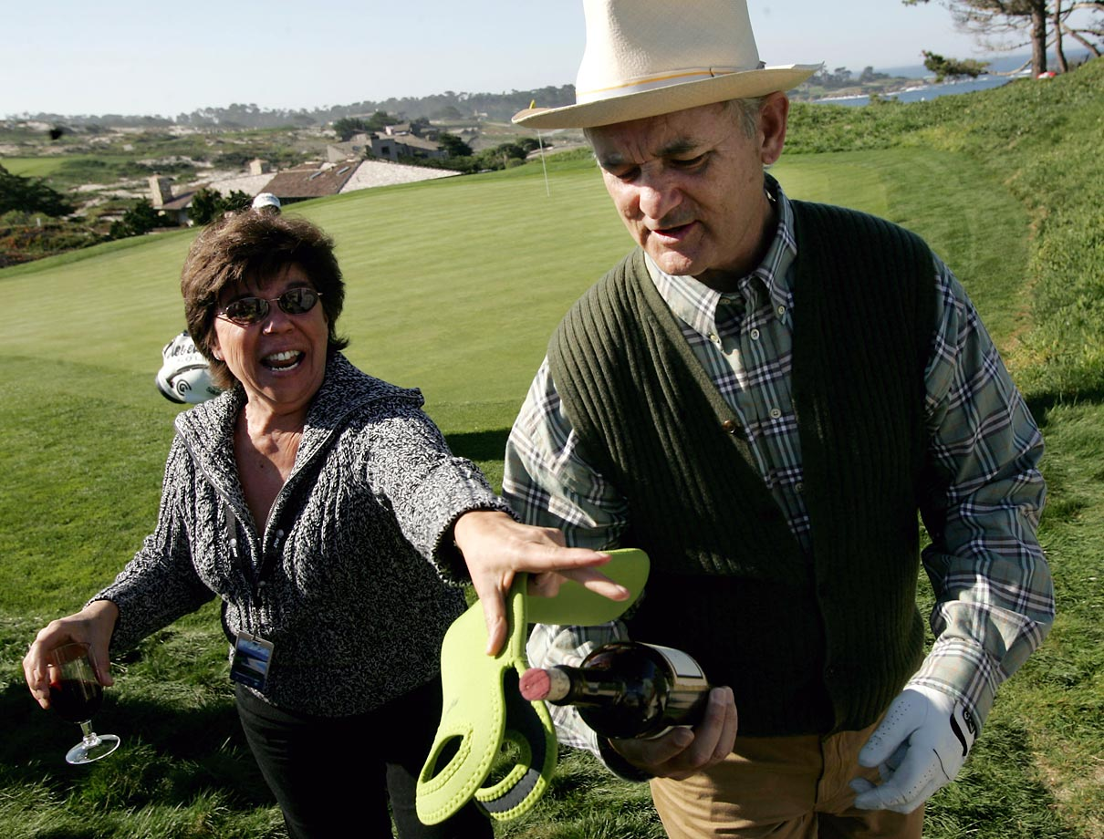 Fan Norma Glaser tries to retrieve her bottle of wine from Bill Murray during the AT&T Pebble Beach National Pro-Am golf tournament on Feb. 10, 2005 in Pebble Beach, Calif.