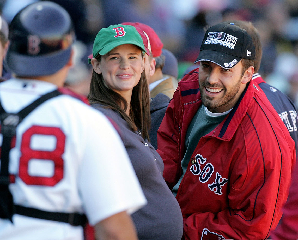 Ben Affleck and Jennifer Garner smile at Boston Red Sox catcher Doug Mirabelli as they attend a game against the New York Yankees on Oct. 1, 2005 at Fenway Park in Boston.