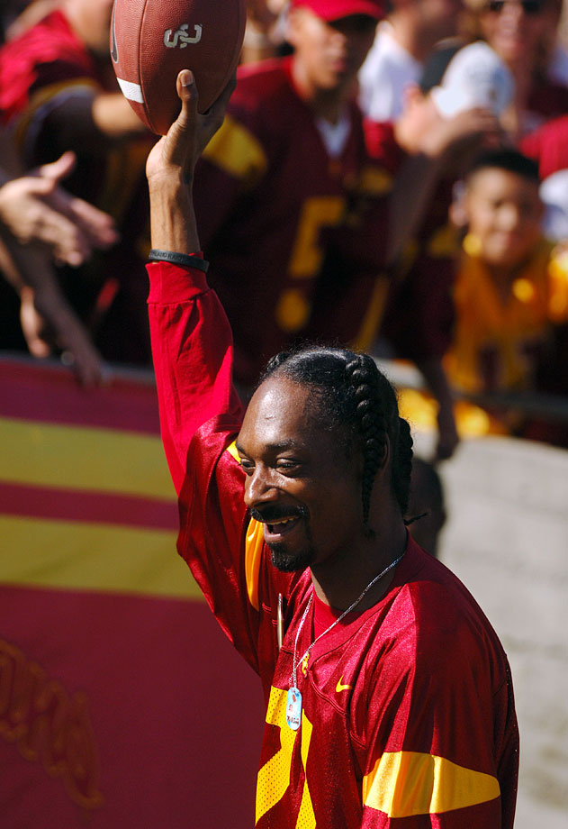 Snoop Dogg holds up a game ball from USC running back LenDale White after a second-quarter touchdown in the Trojans' 55-13 victory over Washington State on Oct. 29, 2005 at the Los Angeles Memorial Coliseum.