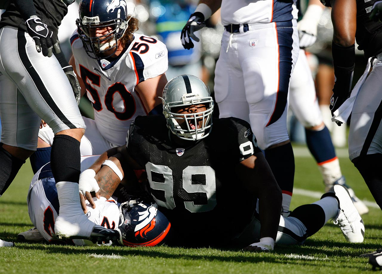 Warren Sapp reacts after tackling Tatum Bell during the Oakland Raiders game against the Denver Broncos on Nov. 13, 2005 in Oakland, Calif.  The Raiders lost the game, 31-17.