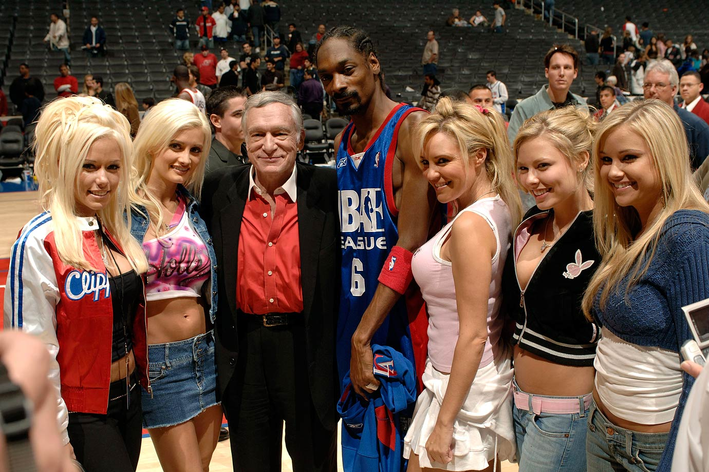 Snoop Dogg poses with Hugh Hefner and his Playboy Playmates during the NBA Entertainment League Charity Basketball Game on Dec. 10, 2005 at Staples Center in Los Angeles.