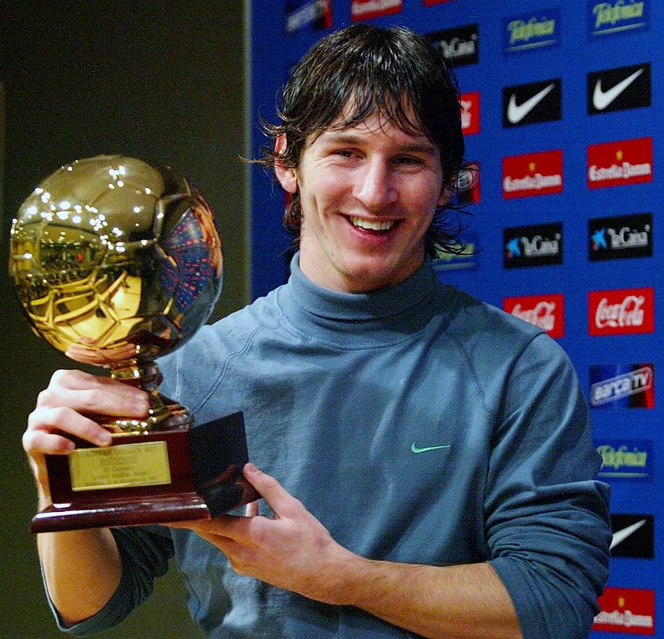 Lionel Messi poses with the Golden Boy trophy awarded by Italian magazine 'Tuttosport' distinguishing the best player under-21 on Dec. 14, 2005 in Barcelona, Spain.
