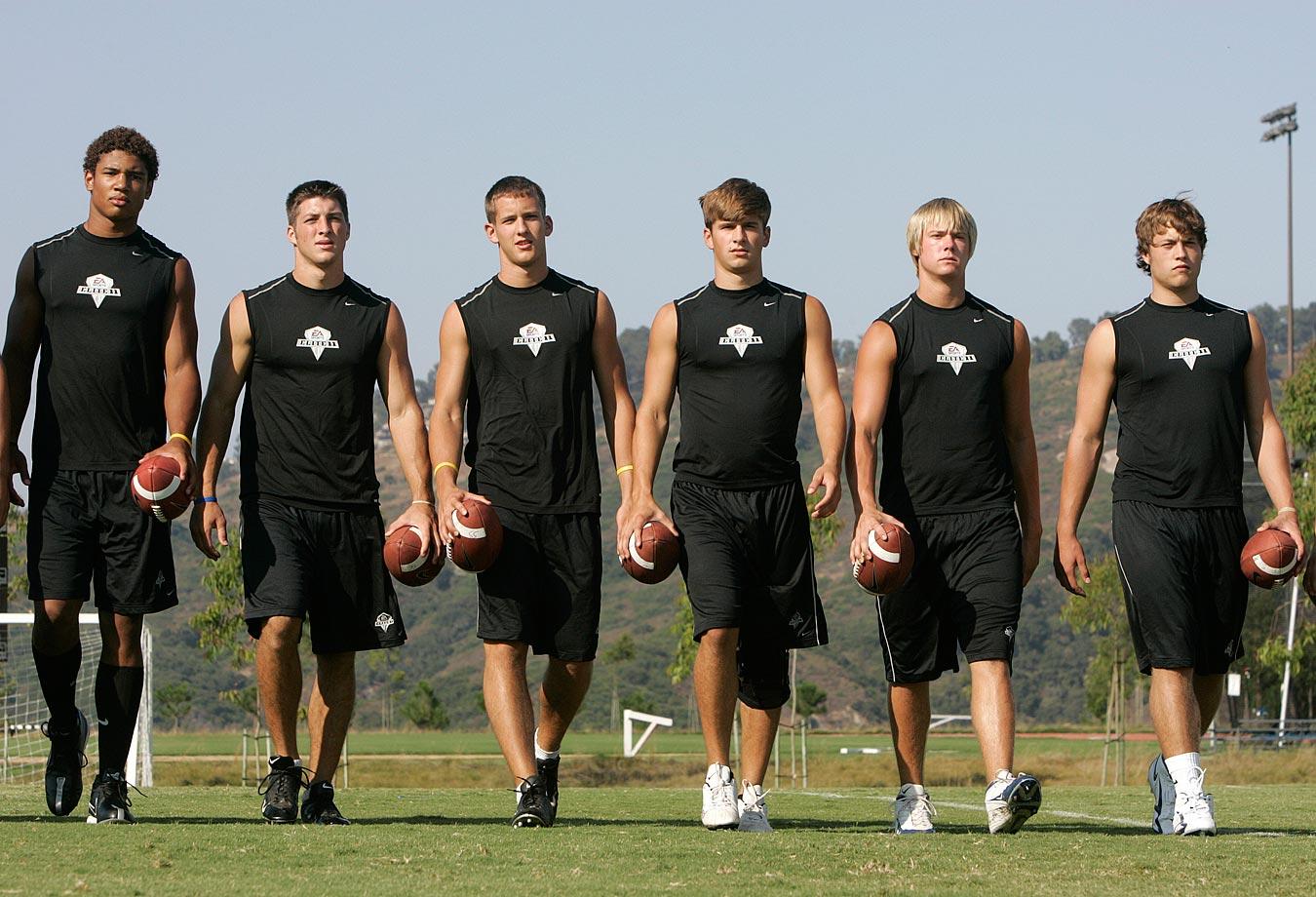Tim Tebow walks with Josh Freeman, Pat Devlin, Neil Caudle, Jevan Snead and Matthew Stafford during quarterback camp.