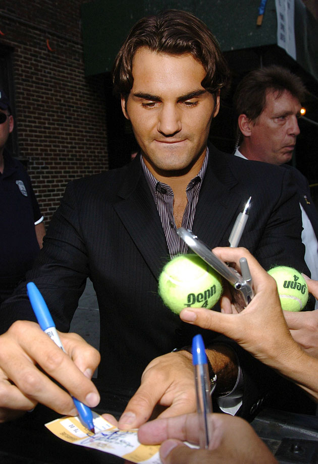 Roger Federer signs autographs for fans outside the Ed Sullivan Theater after appearing on the ''Late Show with David Letterman'' in New York City on Sept. 12, 2005.