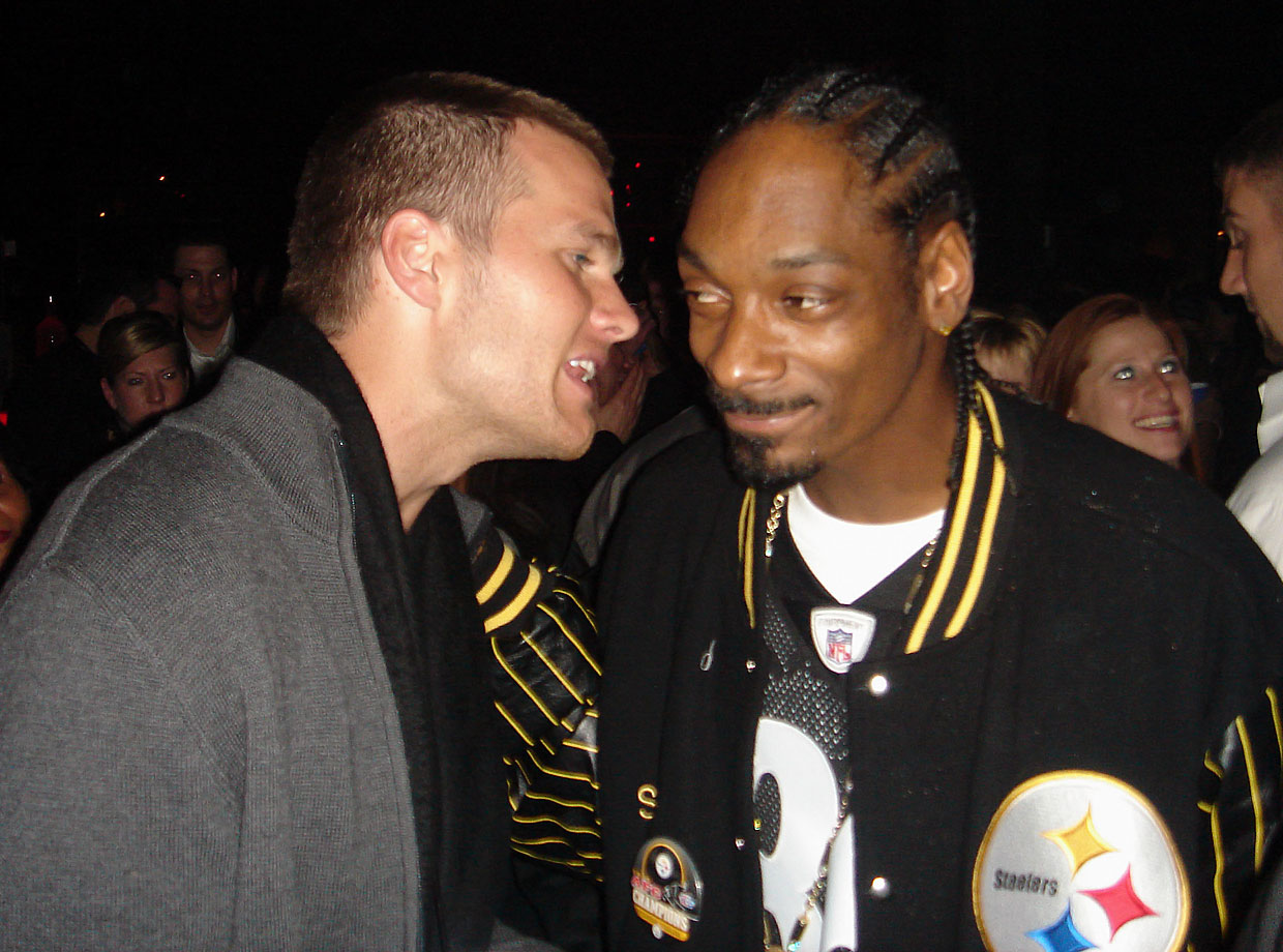 Tom Brady talks with Snoop Dogg during a party on Feb. 3, 2006 before Super Bowl XL in Detroit.