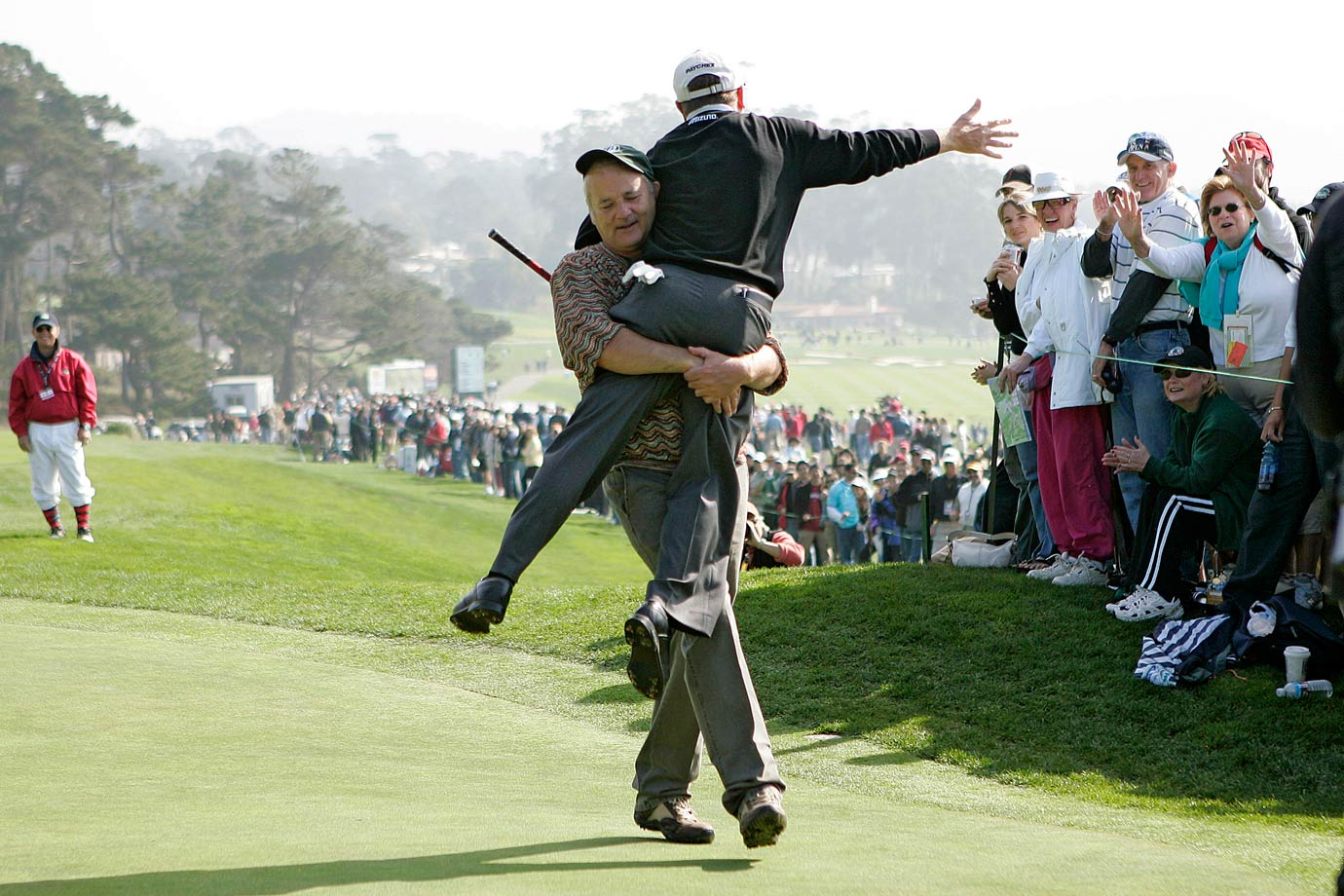 Bill Murray carries Jeff Sluman to the next tee during the AT&T Pebble Beach National Pro-Am golf tournament on Feb. 11, 2006 in Pebble Beach, Calif.