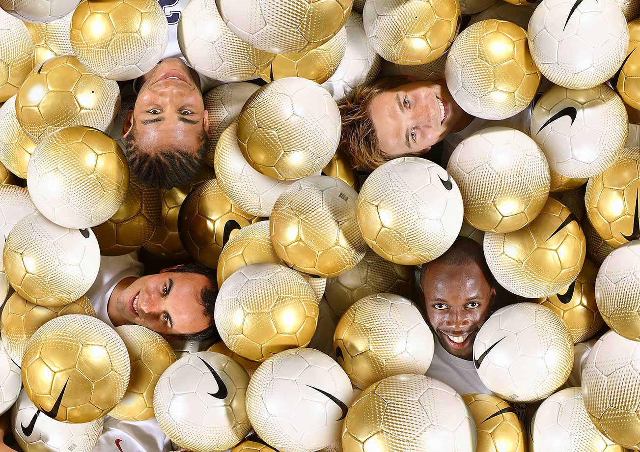 Landon Donovan with teammates Oguchi Onyewu (top, left), Bobby Convey (top, right), and DaMarcus Beasley.