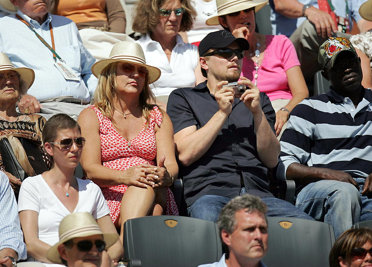 Leonardo DiCaprio and his mother Irmelin Indenbirken watch the French Open Men's Singles Quarterfinals match between Rafael Nadal and Ivan Ljubicic at Roland Garros in Paris, France.