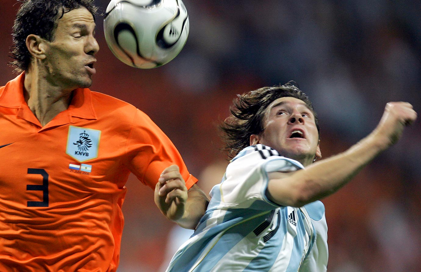 Khalid Boulahrouz and Lionel Messi challenge for the ball during the World Cup Group C soccer match between the Netherlands and Argentina on June 21, 2006 at the World Cup stadium in Frankfurt, Germany.