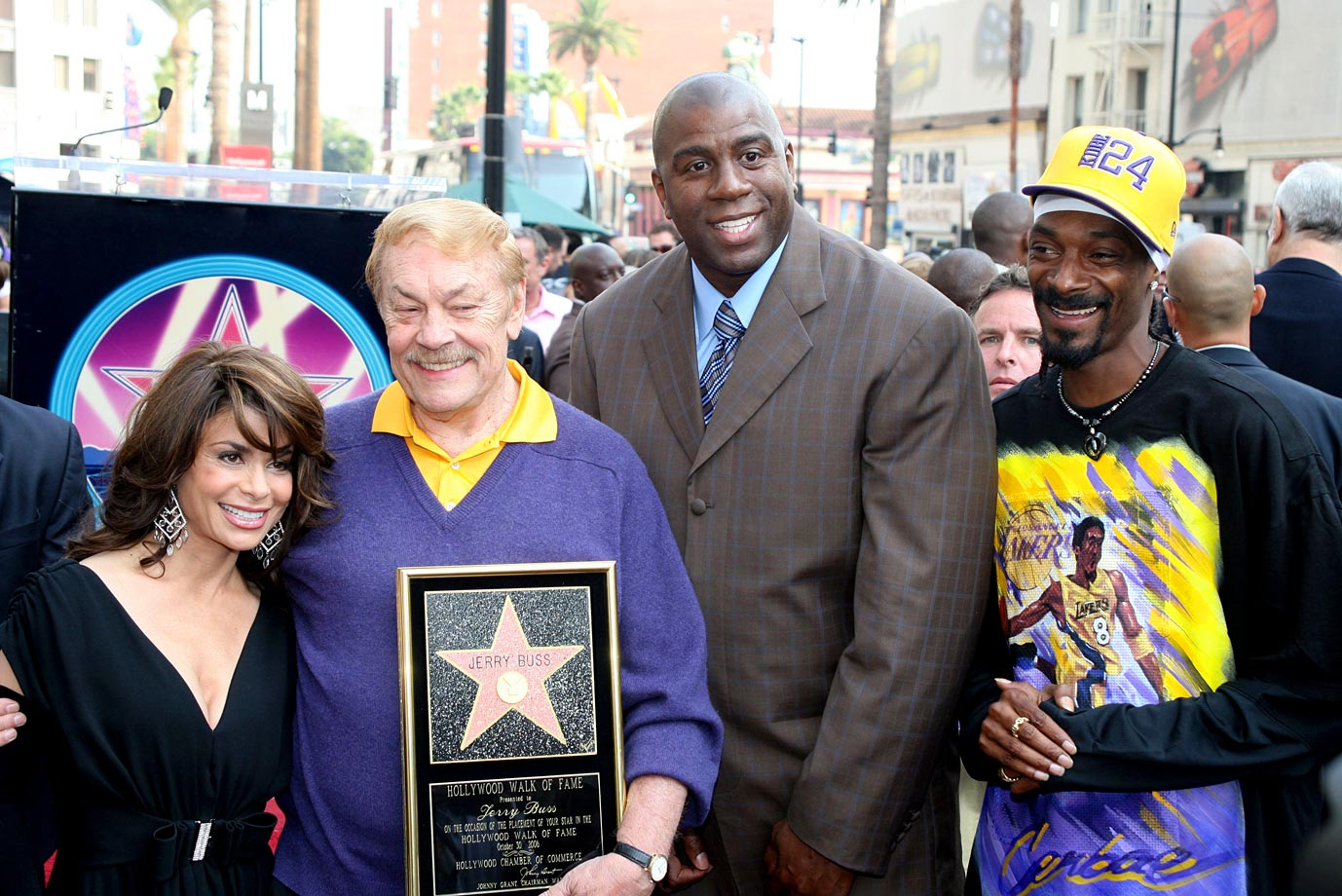 Paula Abdul, Jerry Buss, Magic Johnson and Snoop Dogg pose together after Buss received a star on the Hollywood Walk of Fame on Oct. 30, 2006 in Hollywood, Calif.