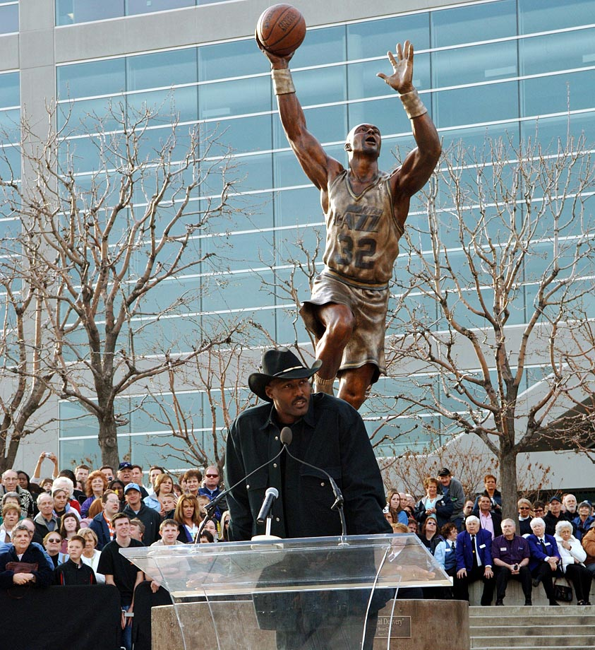 Karl Malone gives a speech at the unveiling of his statue outside the Delta Center in Salt Lake City.