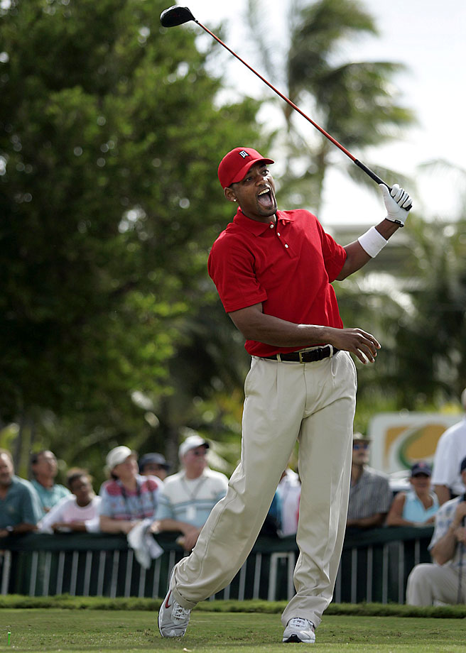 Will Smith reacts to his drive on the first green during the PGA TOUR's Sony Open Pro Am in Honolulu.