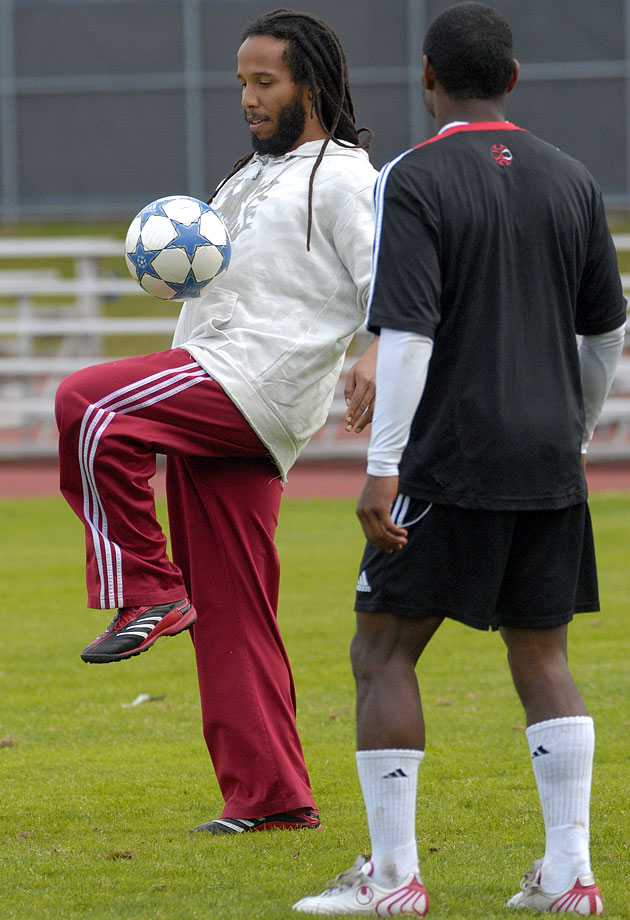 Bob Marley's son Ziggy Marley scrimmages with members of the Canadian national soccer team in Montreal on Sept. 2, 2006, two days prior to Canada's game with Jamaica.