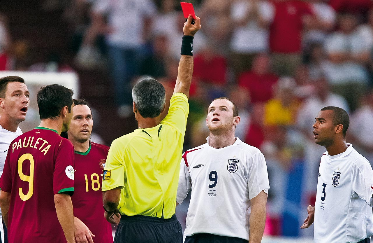 England's Wayne Rooney looks up at the red card as referee Horacio Elizondo sends him off during England's quarterfinal match against Portugal in the 2006 World Cup.