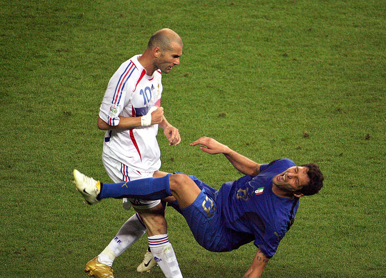 Zinedine Zidane ends his international career in infamy by head-butting Marco Materazzi in the 2006 World Cup final.
