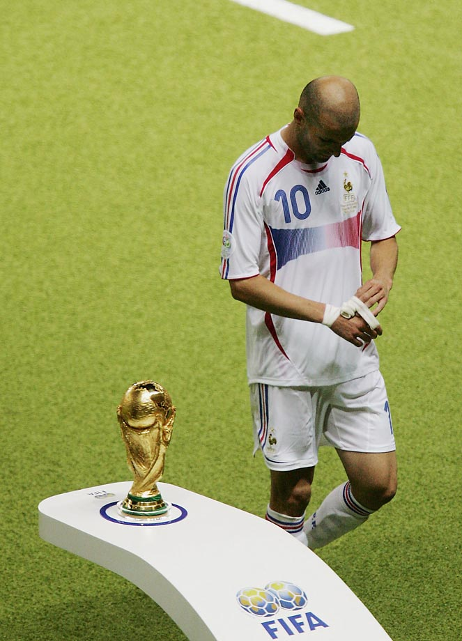Zinedine Zidane walks past the World Cup trophy after being sent off in the final match of the 2006 World Cup.