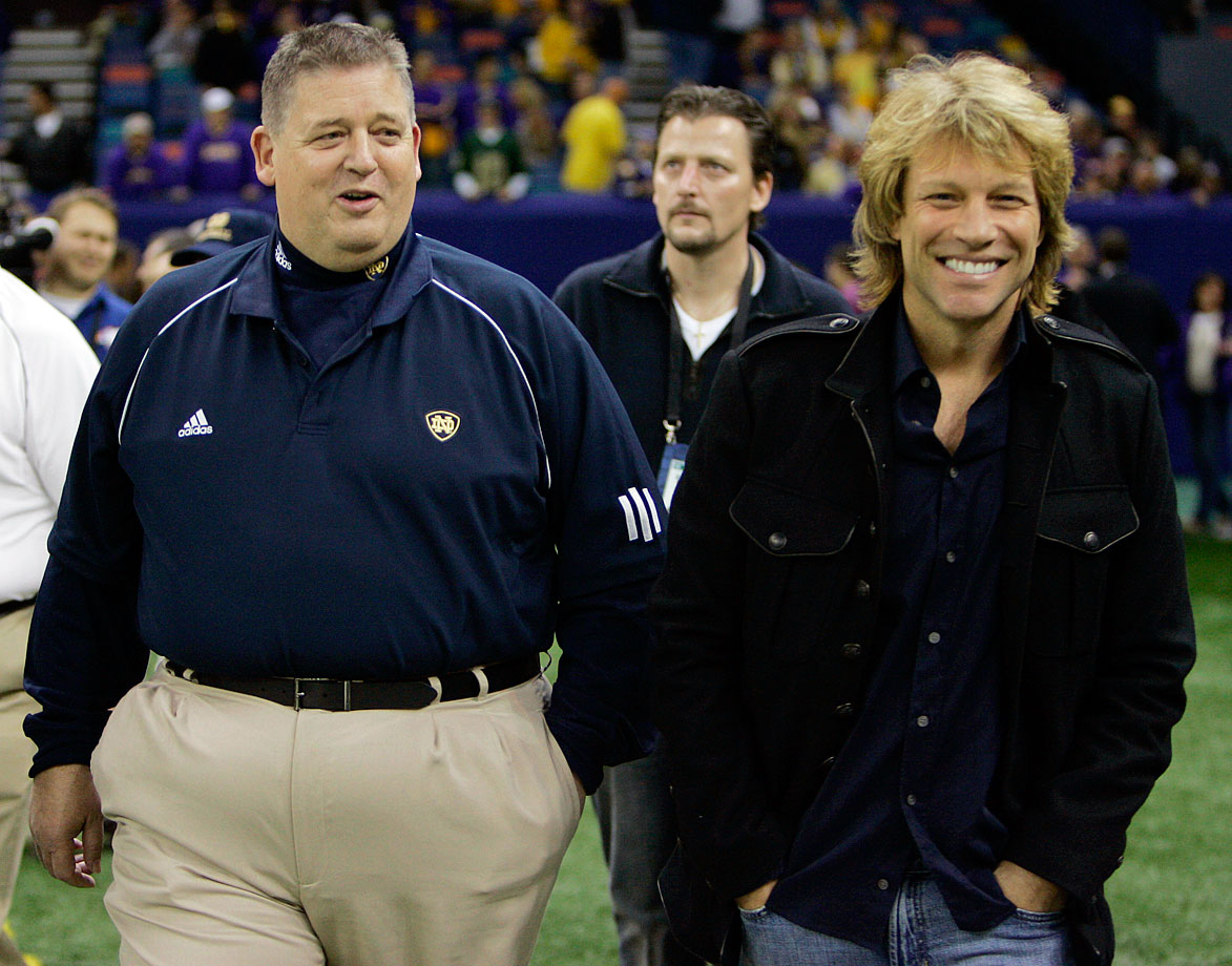 Notre Dame head coach Charlie Weis walks with Jon Bon Jovi prior to the Sugar Bowl between Notre Dame and LSU at the Louisiana Superdome in New Orleans.