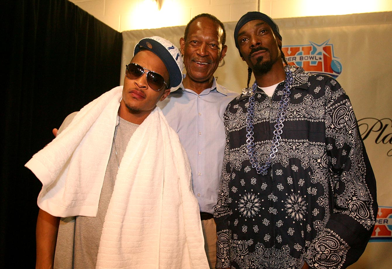 NFLPA Executive Director Gene Upshaw poses for a photo backstage with T.I. and Snoop Dogg at the NFL Players Party on Feb. 2, 2007 at the American Airlines Arena in Miami.