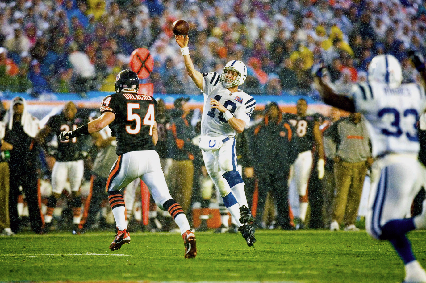 Indianapolis Colts quarterback Peyton Manning throws an off-balance pass against the Chicago Bears. Manning led the Colts to a 29-17 victory, giving him his only Super Bowl title.