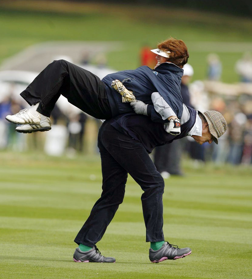 Bill Murray carries a fan on his back during the AT&T Pebble Beach National Pro-Am golf tournament on Feb. 10, 2007 in Pebble Beach, Calif.