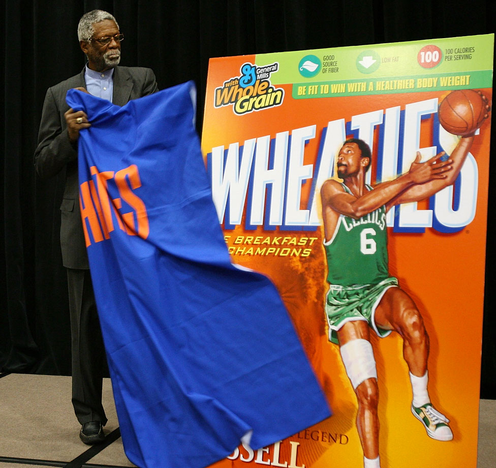 Russell unveils a new Wheaties box featuring his picture during a ceremony.