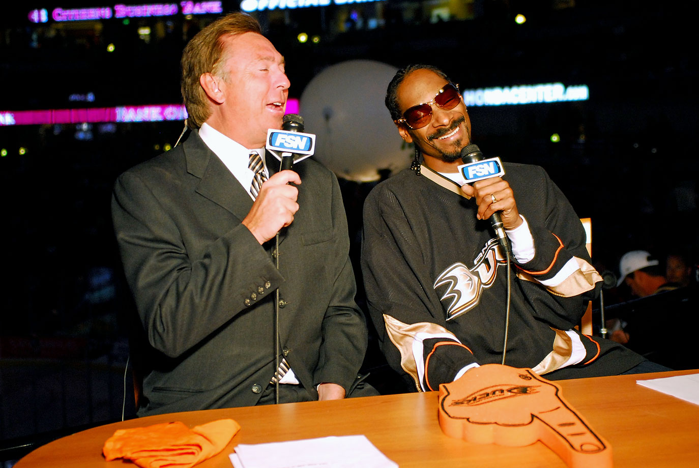 Snoop Dogg joins broadcaster Bill Macdonald in the booth during Game Five of the Western Conference Quarterfinals between the Anaheim Ducks and Minnesota Wild on April 19, 2007 at the Honda Center in Anaheim, Calif.