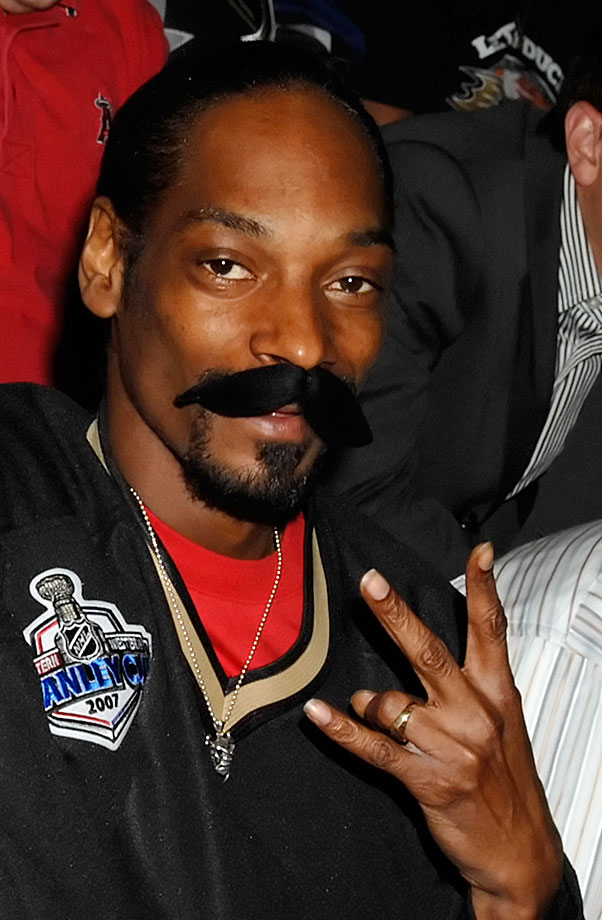 Snoop Dogg poses with a fake mustache as a tribute to George Parros of the Anaheim Ducks during Game Two of the NHL Stanley Cup Finals between the Ducks and Ottawa Senators on May 30, 2007 at Honda Center in Anaheim, Calif.