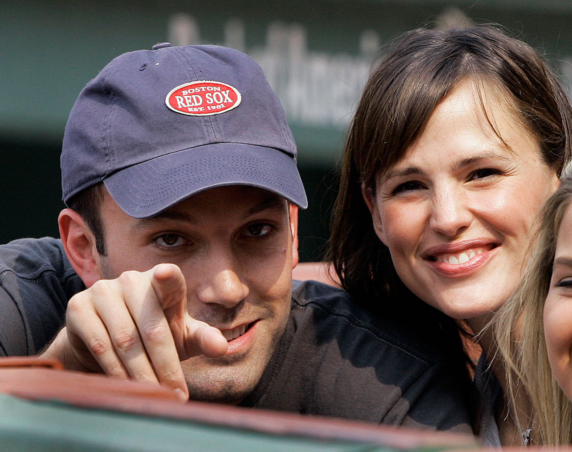 Ben Affleck and Jennifer Garner smile as they sit next to the Boston Red Sox dugout prior to the start of their game against the New York Yankees on June 2, 2007 at Fenway Park in Boston.