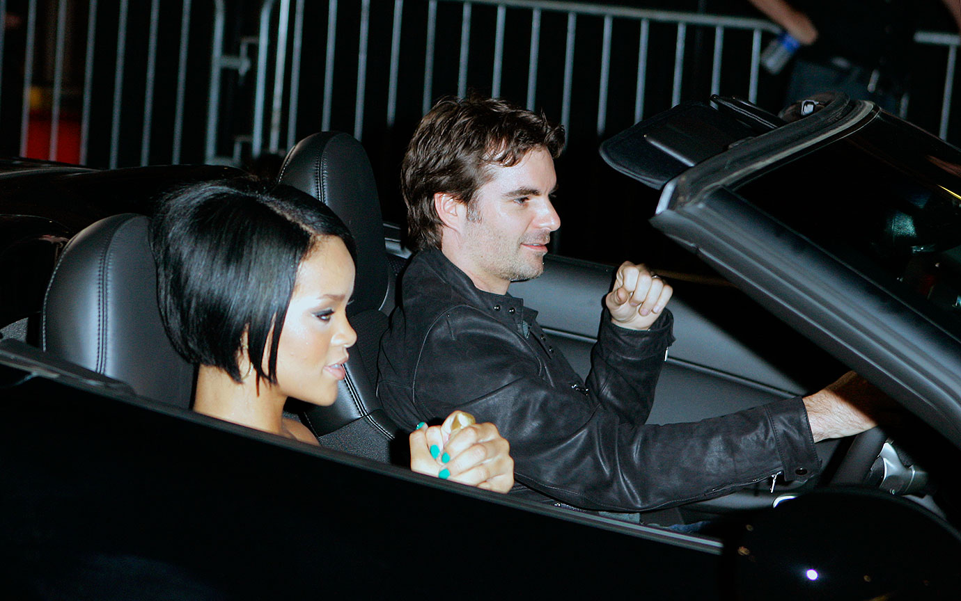 Jeff Gordon arrives as Rihanna rides along at the California Speedway's NASCAR party on Aug. 29, 2007 in Los Angeles.