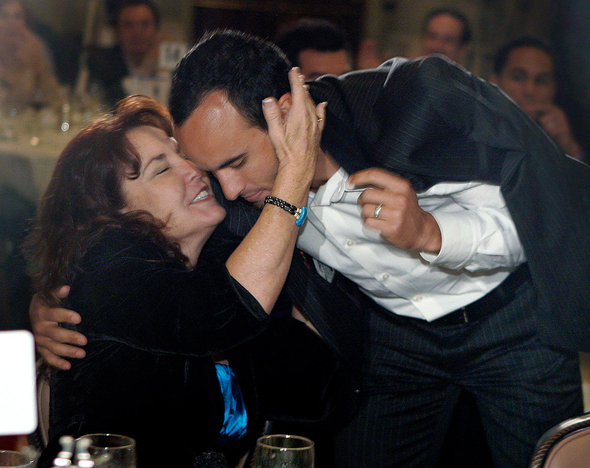 Landon Donovan receives a kiss from his mother, Donna Kenney-Cash, after winning the Honda Player of the Year Award.