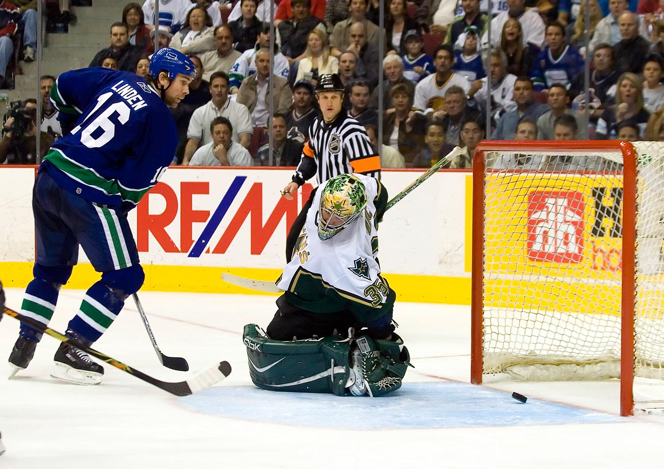 The series was a war, with the Stars climbing out of a three-games-to-one hole. Three of the seven games were settled in an extra session -- including a four-OT thriller in Game 1, won by the Canucks, 5-4, with goalie Roberto Luongo making 72 saves in his postseason debut. Vancouver advanced on home ice as its longtime hero Trevor Linden, a veteran of eight career Game 7s, broke a 1-1 tie by tipping a Mattias Ohlund shot past Stars goalie Marty Turco seven minutes into the third period. Bryan Smolinski and Taylor Pyatt later added empty-netters.