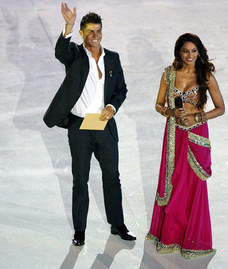 Cristiano Ronaldo and Bollywood actress Bipasha Basu attend the debut of the New Seven Wonders of the World at Luz stadium in Lisbon.