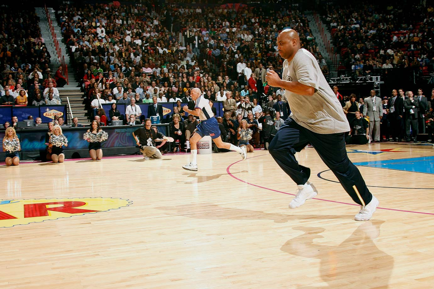 Charles Barkley races NBA referee Dick Bavetta during NBA All-Star Saturday Night in Las Vegas. Barkley won the race.