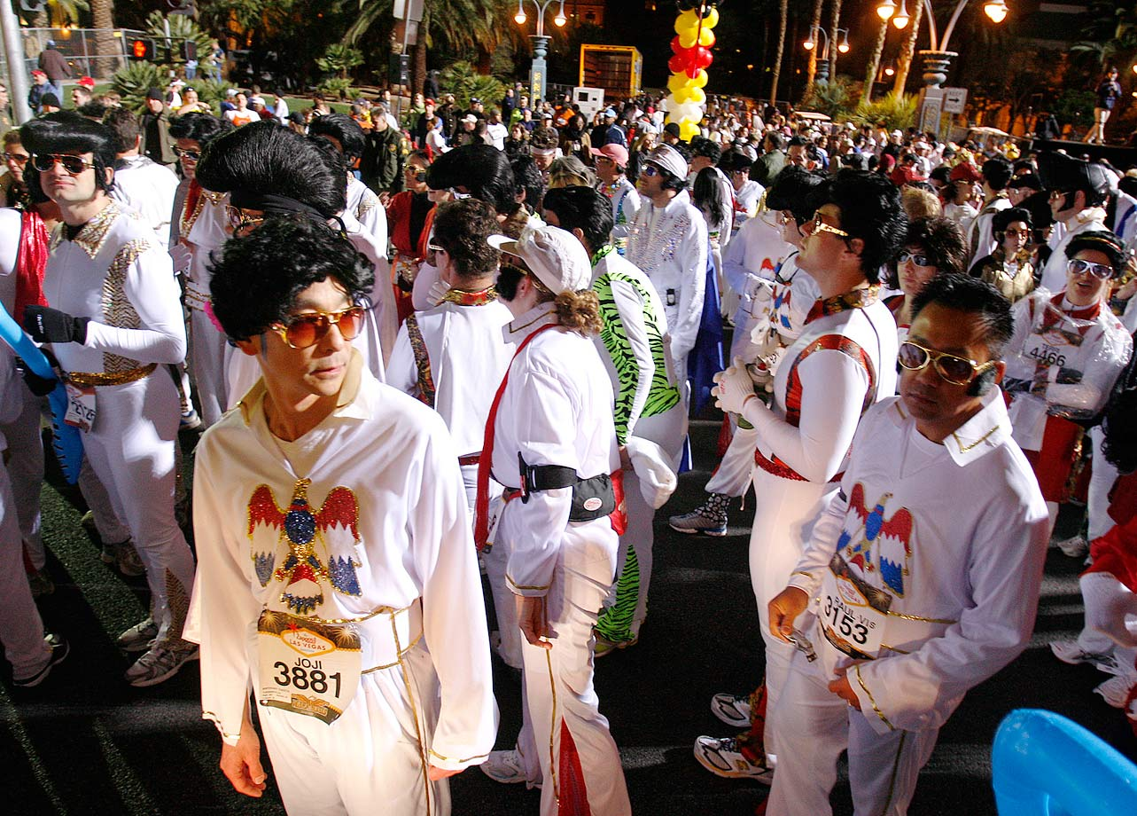 Runners dressed as Elvis Presley get ready for the start of the 2007 Las Vegas Marathon.