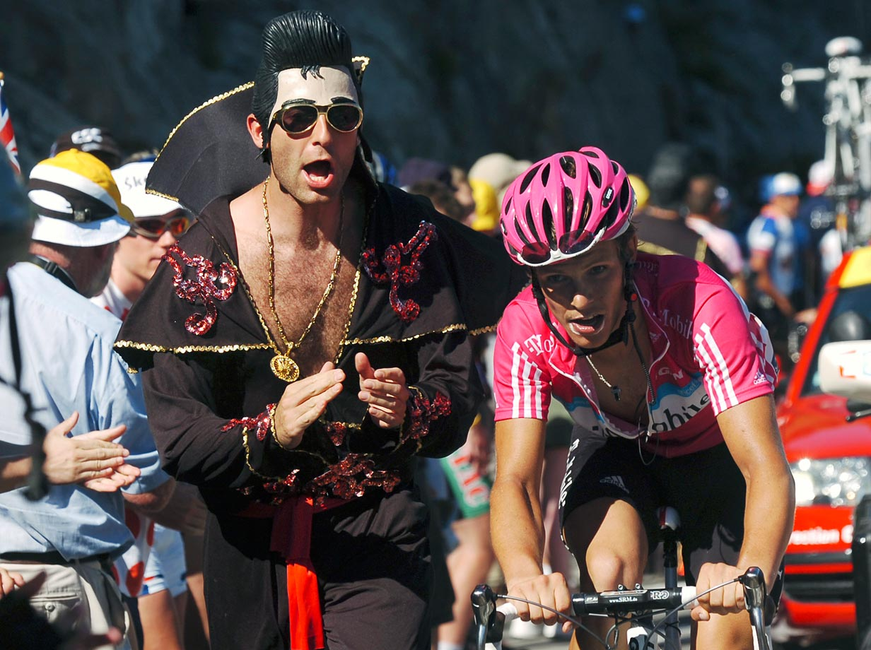Germany's Linus Gerdemann rides past a fan dressed as Elvis Presley during the seventh stage of the 2007 Tour de France.