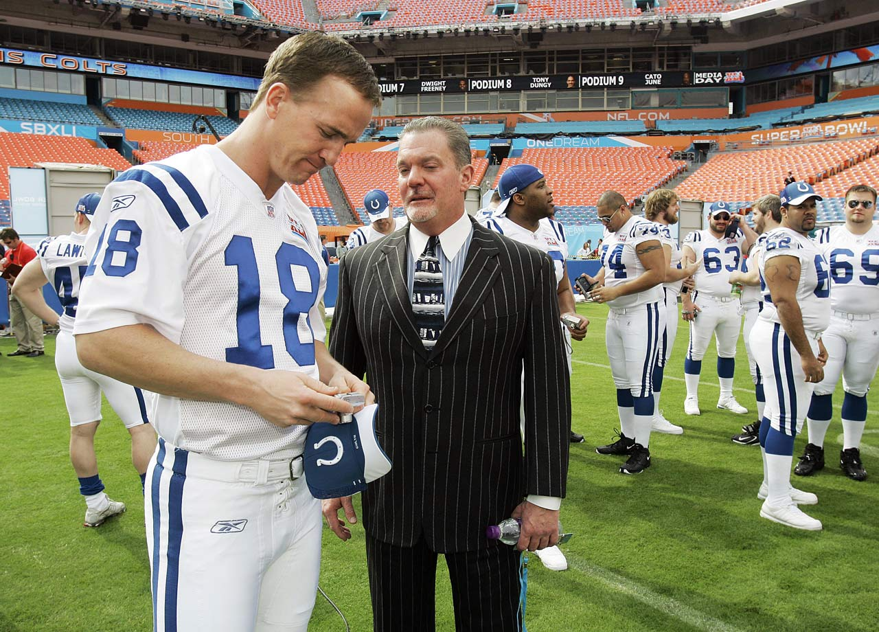 Peyton Manning chats with Colts owner Jim Irsay during Media Day prior to Super Bowl XLI. Manning was the MVP of the game, leading the Colts to a decisive victory over the Bears. Manning turned the downtrodden Colts into a perennial Super Bowl contender during his days in Indy, leading the team to eight division championships and three AFC championship games.