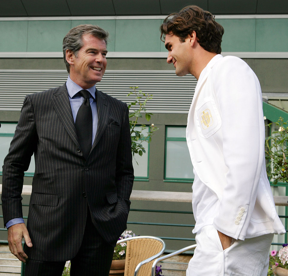 Pierce Brosnan meets Roger Federer during an interview for the BBC on day eleven of Wimbledon in London on July 6, 2007.