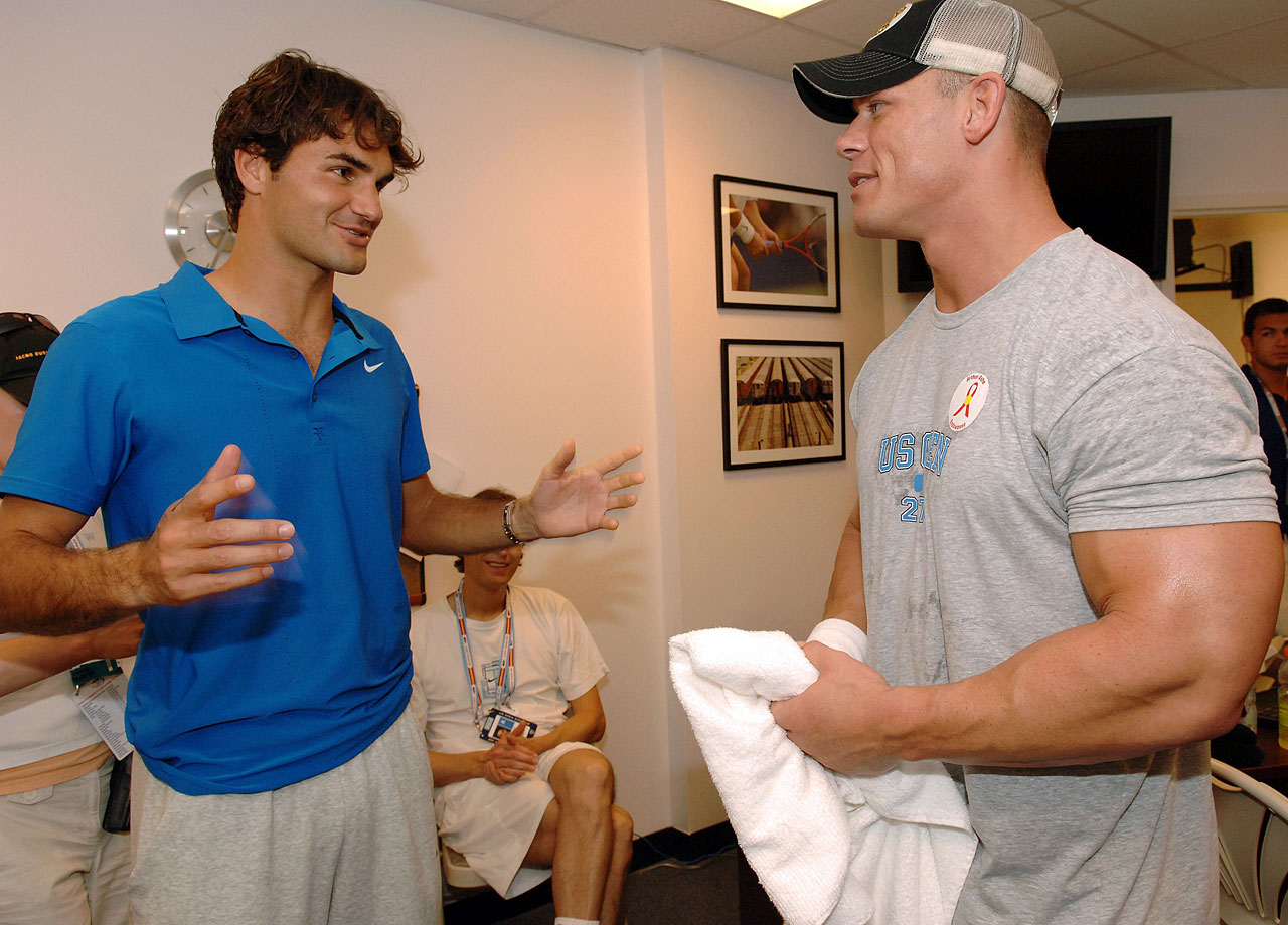 Roger Federer talks with WWE pro wrestler John Cena during the U.S. Open in the Queens borough of New York City on Aug. 25, 2007.