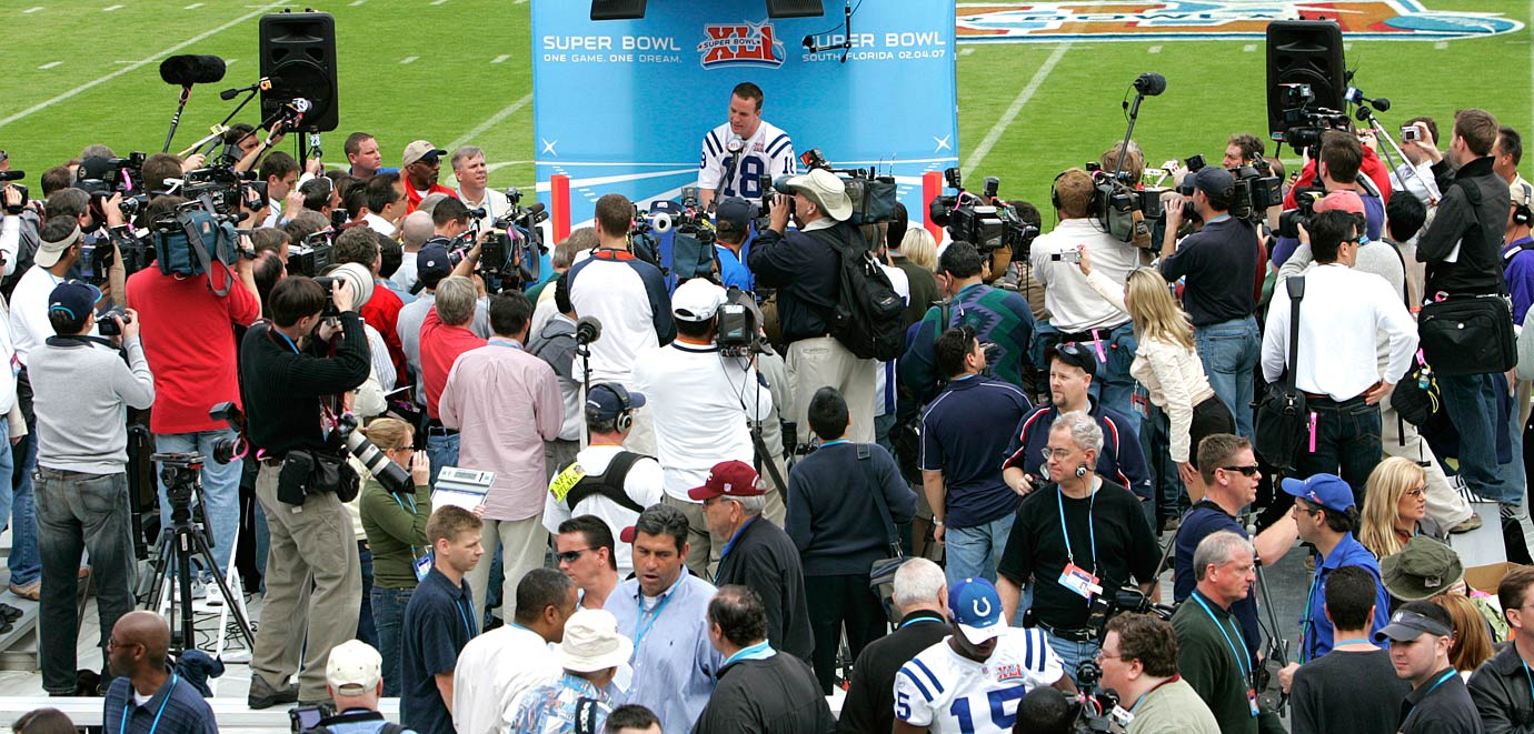 Peyton Manning speaks to a lot of reporters during Media Day for Super Bowl XLI at Dolphin Stadium in Miami.