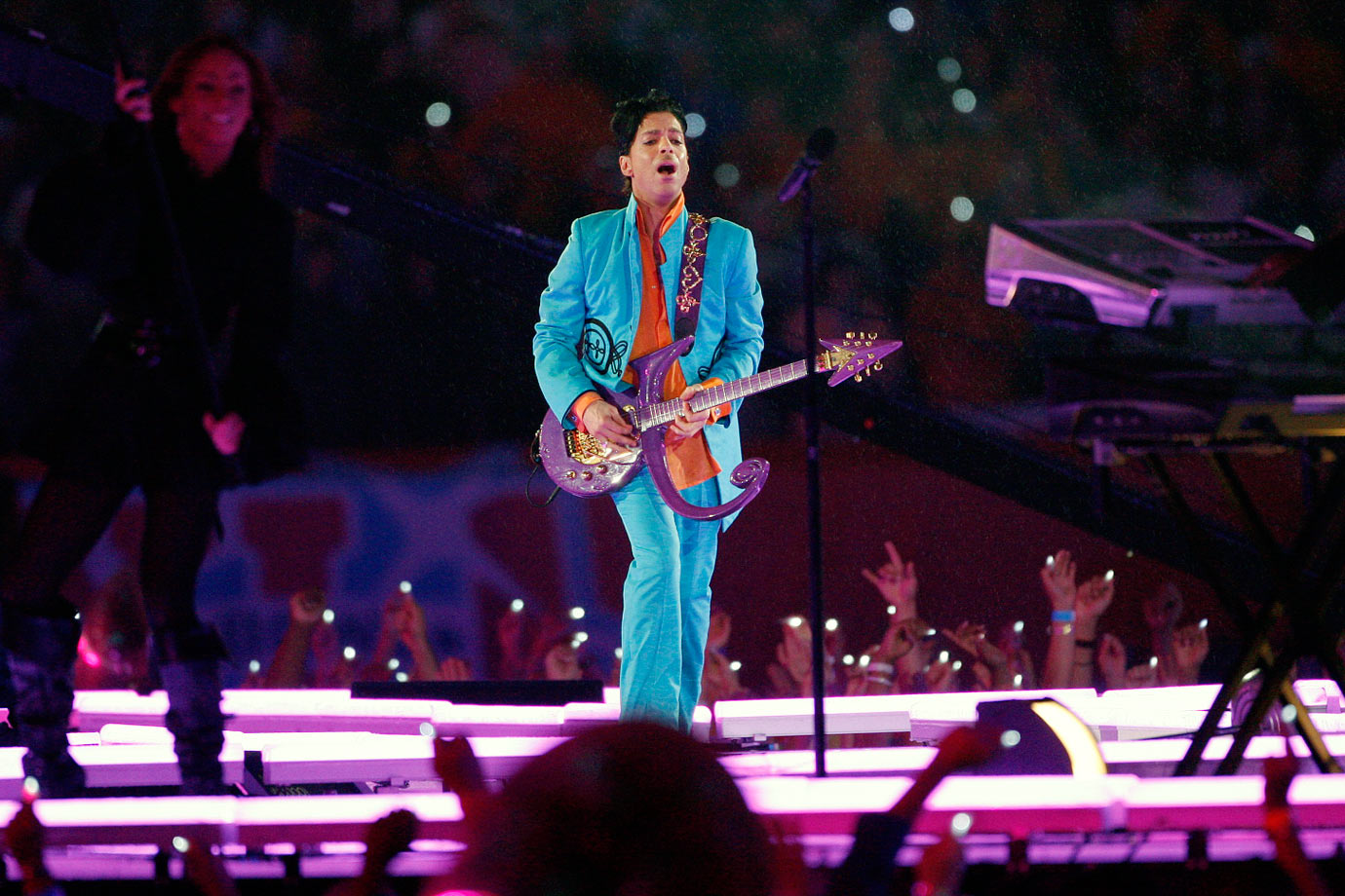 "The artist currently known as Prince put on a royal performance. The 1980s icon launched into ""Let's Go Crazy"" and covered ""Along The Watchtower,"" ""Proud Mary"" and the Foo Fighters' ""Best Of You."" Finally, he brought the house down with ""Purple Rain"" in a coincidental downpour. The phallic imagery caused a minor stir. It's just a guitar, people."