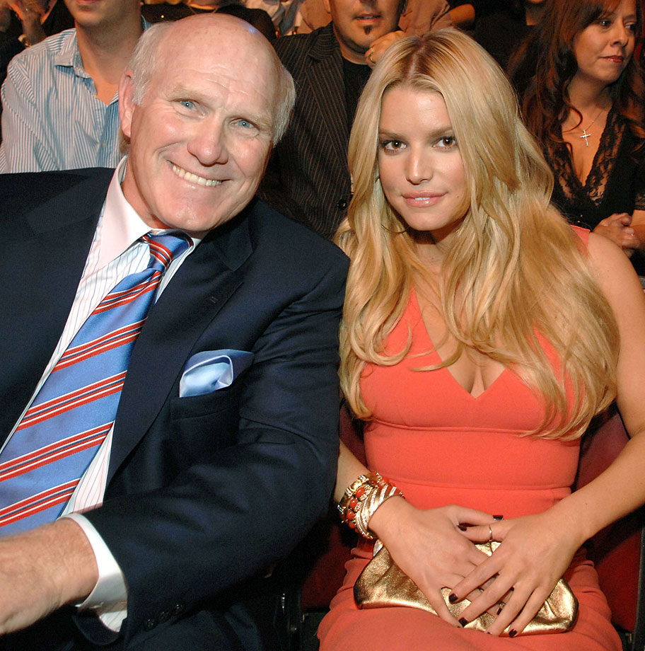 Terry Bradshaw and singer/actress Jessica Simpson enjoy the CMT Giants honoring Hank Williams Jr. at the Gibson Amphitheatre.