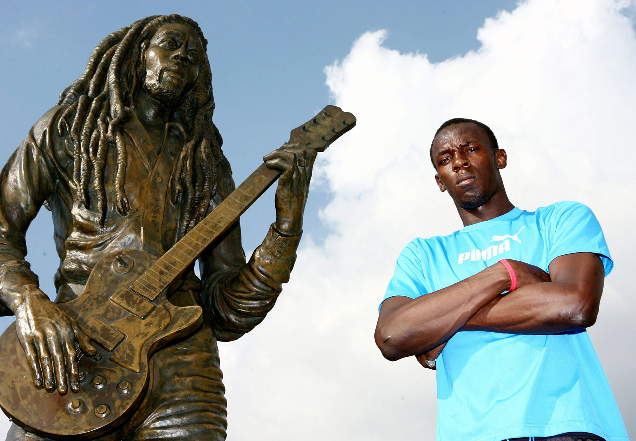 Usain Bolt poses next to the legendary Bob Marley statue in Kingston, Jamaica, on Oct. 19, 2007.