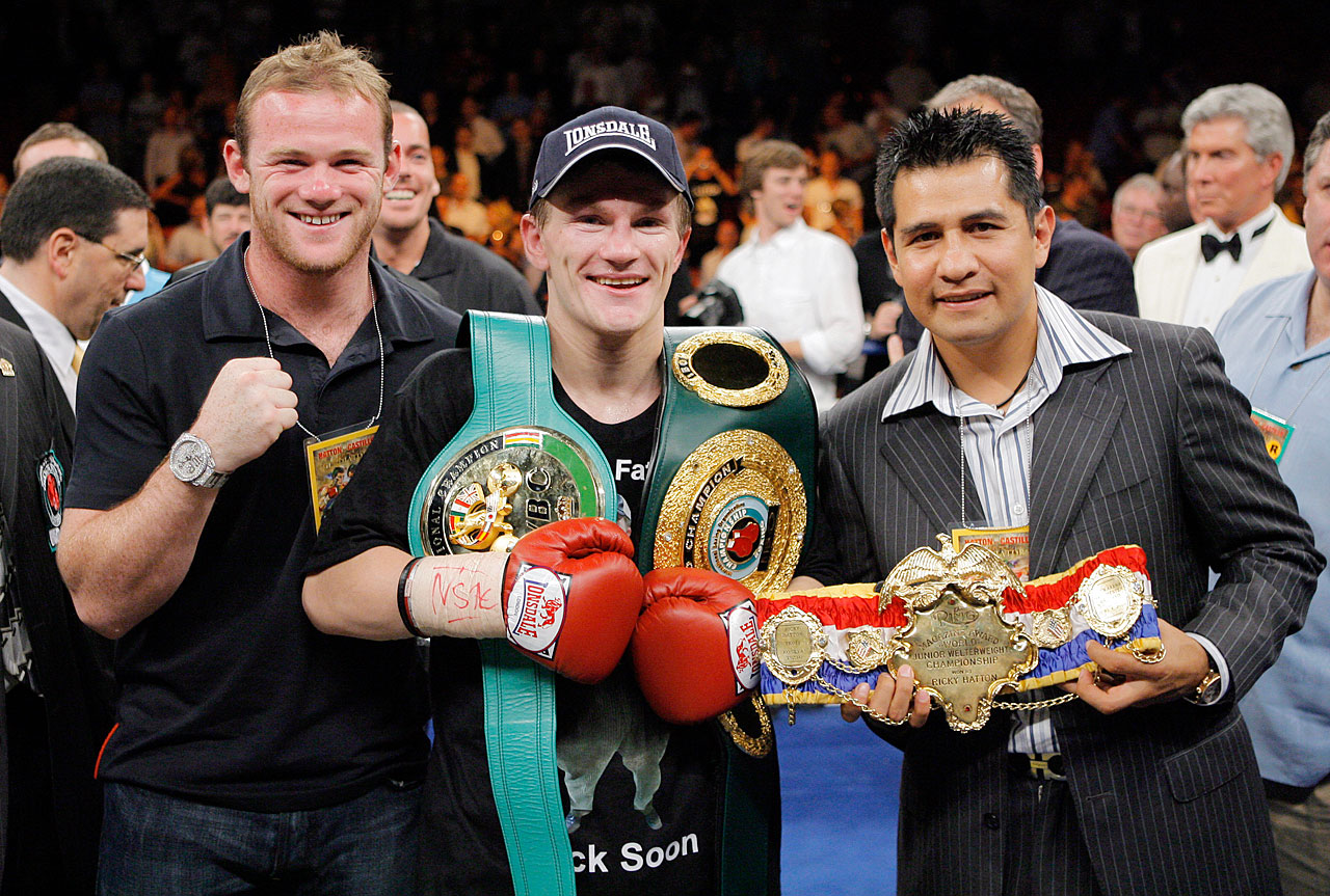 Rooney poses with Ricky Hatton and Marco Antonio Barrera after Hatton's victory over Jose Luis Castillo on June 23, 2007 in Las Vegas.