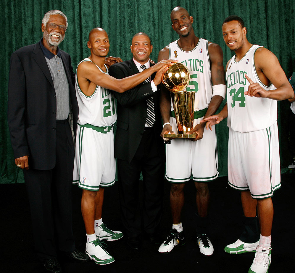 Bill Russell poses with Celtics Ray Allen, coach Doc Rivers, Kevin Garnett and Paul Pierce after they led Boston to a championship-clinching victory over the Lakers in the 2008 NBA finals. It was the 17th title in organization history.