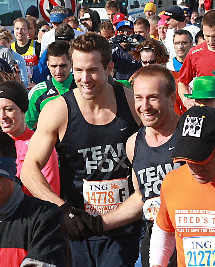 Ryan Reynolds shakes hands with one of his running mates as they begin the 2008 NYC Marathon to help raise money for the Michael J. Fox Foundation for Parkinson's Research on Nov. 2, 2008 in New York City.